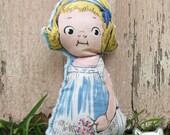 stuffed doll with blue minkee back