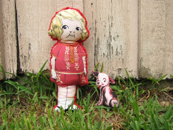 Stuffed Doll with red plush back