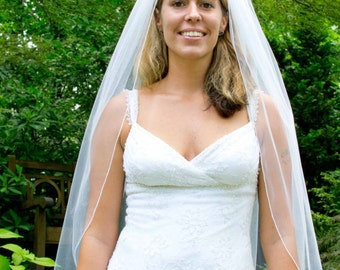 Wedding veil - fingertip length bridal veil with a delicate finished edge