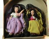 Lot of two hard plastic Souvenir dolls in pretty decorative box