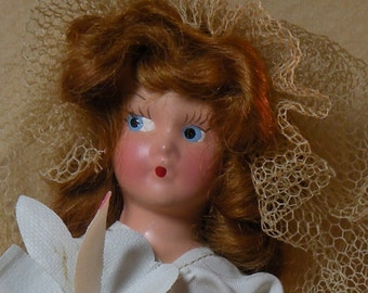 Tagged Eugenia painted bisque doll