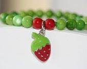 Girl's Peridot/Green Shell Bead Bracelet with Strawberry Charm
