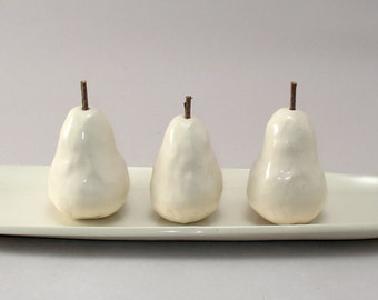 Three Tiny Pears with Little Twig Stems on an Oval Tray with a Soft Ivory Finish