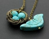 Turquoise bird and a nest lariat Necklace - Brass