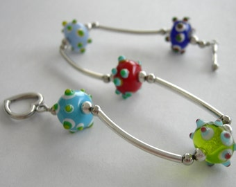 SALE - Bracelet Multi-Colored Glass Beads and Sterling Silver Noodle Beads