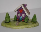 Miniature House sculpture with purple house