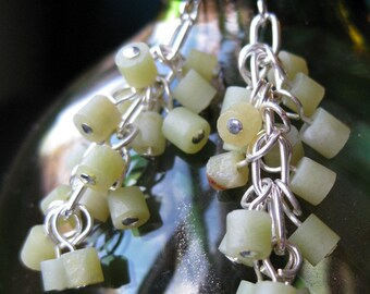 Matte jade and silver plated dangle earrings