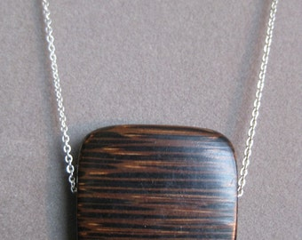 Sublime simple square palm wood bead on silver chain