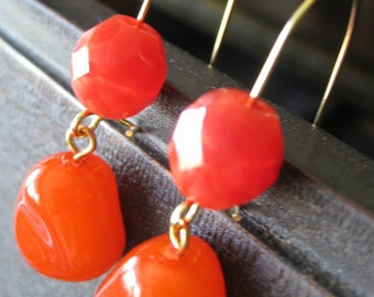 Red-orange dangle earrings