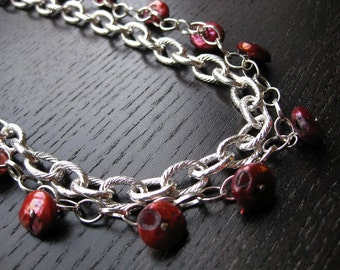 Layered crimson pearl statement necklace