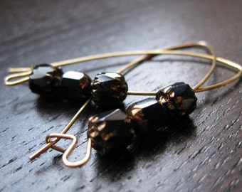 Black and golden cathedral glass earrings