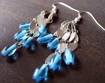 Cyan-colored glass and chain earrings