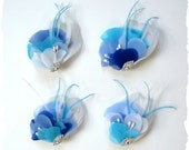 Ocean Breeze feather and chiffon hair clip shown in blue, teal, ivory, white with rhinestones