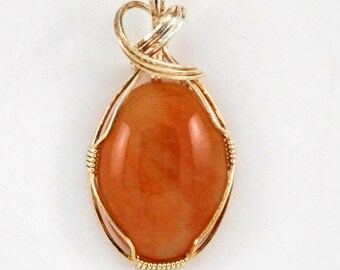 Oval Peach color agate pendant with 14k Gold Filled wire wrap - P136