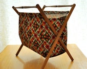 vintage sewing or knitting basket on wooden stand