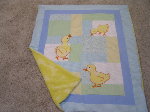 Trio of ducks waddling on a blanket