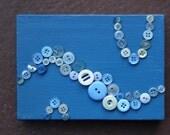 5 x 7 -- blue buttons on ocean blue canvas
