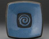small blue raku fired plate with spiral