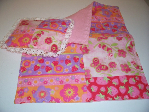 Doll bedspread/blanket with matching pillow.