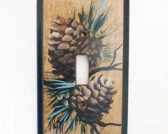 Single switchplate with pinecones