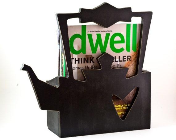 magazine rack\/ distressed black kettle.