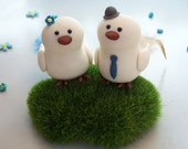 Unique, cute Love birds wedding cake toppers with faux grass base and feathers