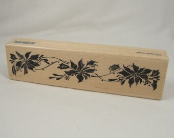 Poinsettia Edge stamp by Penny Black