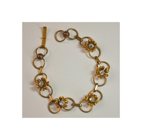 Open Design Gold Tone 3 Dimensional Flower with Aurora Borealis Rhinestone Bracelet