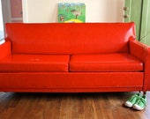 CaSTRo CoNVeRTiBLe SoFa SLeePeR . A CLaSSiC ORiGiNaL . CHeRRY FiRe ENGiNe ReD