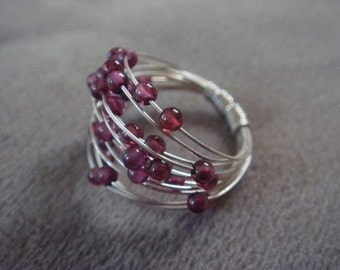Teeny Garnet Spiral Silver Ring