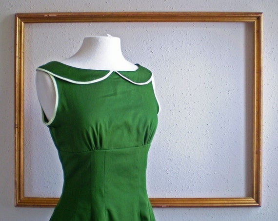 kelly retro dress with collar , contrasting trim and sleeveless.