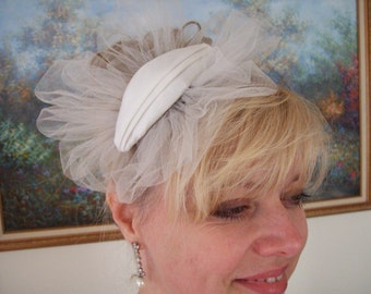 Pleated petite oval hat with ruffled tulle pouf