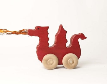 Homeless red dragon wood toy