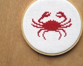 cross stitch crab will nibble your toes.  chomp.