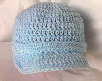 Crocheted Brimmed Cap with Strap and Crocheted Button - Light Blue