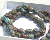 Full 15 inch Strand of Blue Calsilica Jasper Barrel Beads