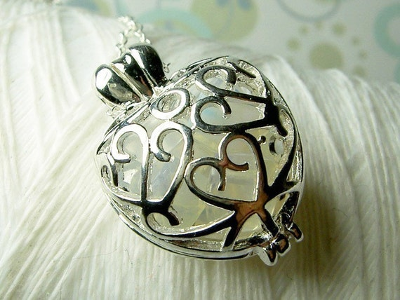 Worry Locket - opal gemstones in filigree heart locket and sterling silver necklace