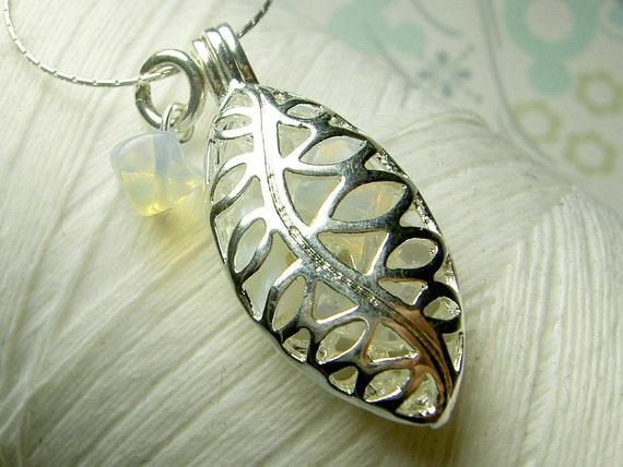 Worry Locket - opal gemstones in filigree leaf locket and sterling silver necklace