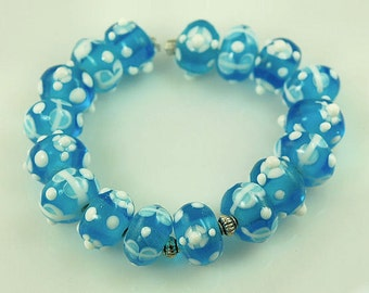 17 High Quality Lampwork Glass Beads - Teal Blue Glass with White Flowers