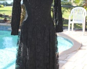 110405- 01  Vintage black lace cocktail dress by designer  Florencia Fuime   349