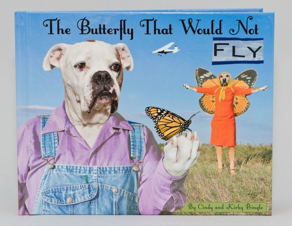 The Butterfly That Would Not Fly, new hardback book with dogs wearing clothes helping a monarch butterfly by Pringle of Dogtown Artworks