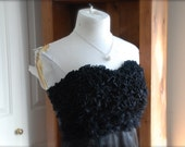 Sophie. A classic and timless ruffled little black dress.