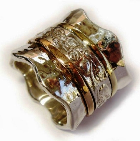 spinner spinning ring silver gold designer jewelry by