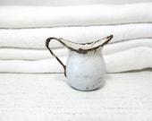 RESERVED -Tiny Vintage Enamelware Pitcher