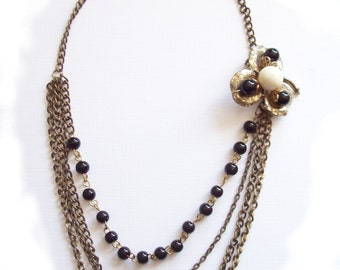 Statement necklace with vintage brooch