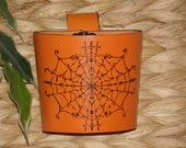 Leather Cup Cozy with finger-tip loop and permanent inked Spidey images.