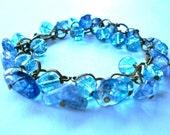 Blue charm bracelet, antique brass chain jewelry with blue ice flake quartz and crackle glass bead dangles, blue bracelet