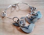 RESERVE for Yordanka - sterling dove bracelet: a dule of doves