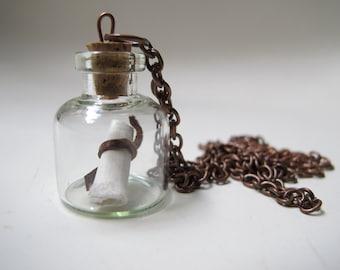 Secret message in a bottle. Necklace