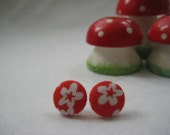 Medium sized red earrings with white flower